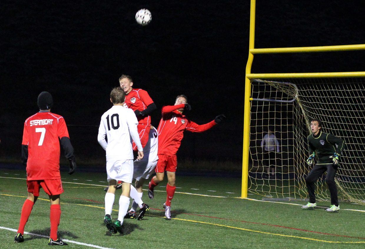 The Steamboat defense rises up to defend near its own goal Tuesday in a game at Summit High School. The Tigers kept the pressure on the Sailors throughout the game and cashed in for three goals and a 3-0 win.