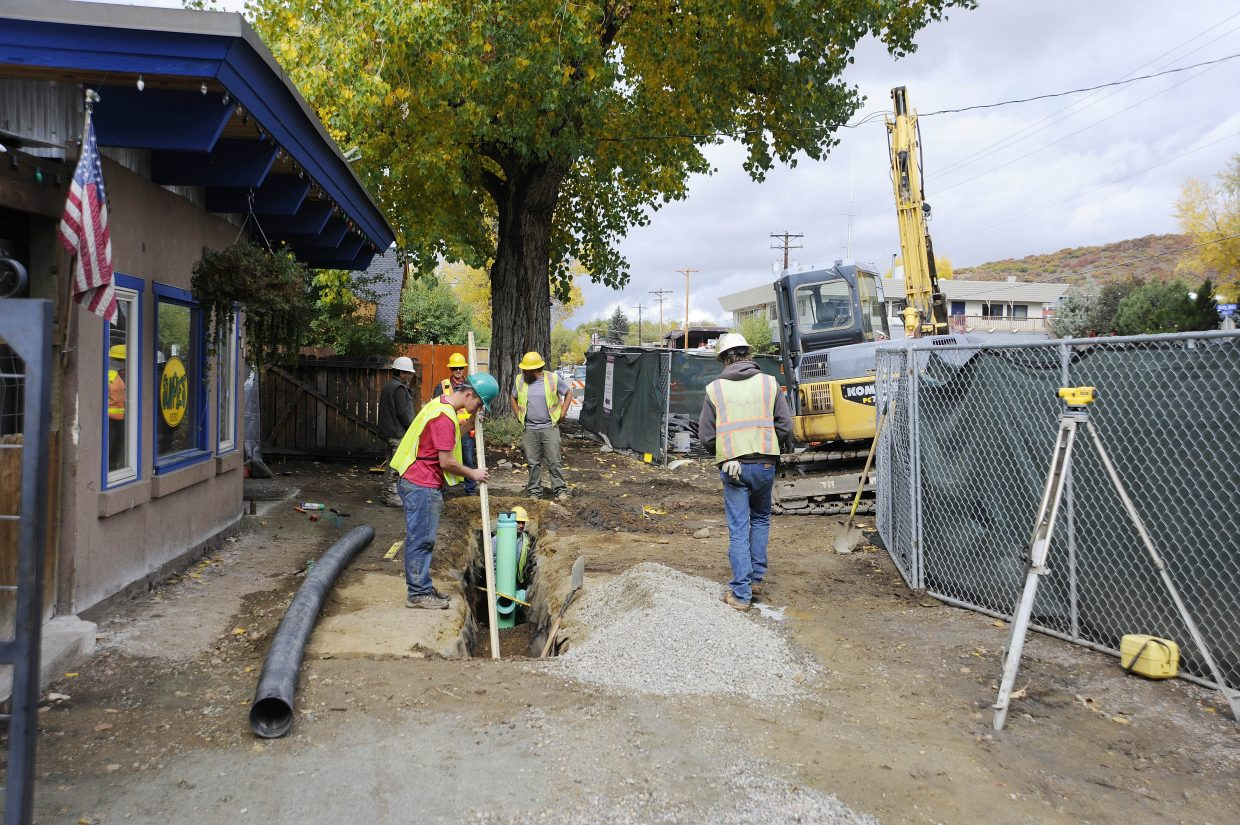 Work is progressing on the Yampa Street improvement project. On Friday, workers were installing a drain in front of Sunpies Bistro so the area does not flood.