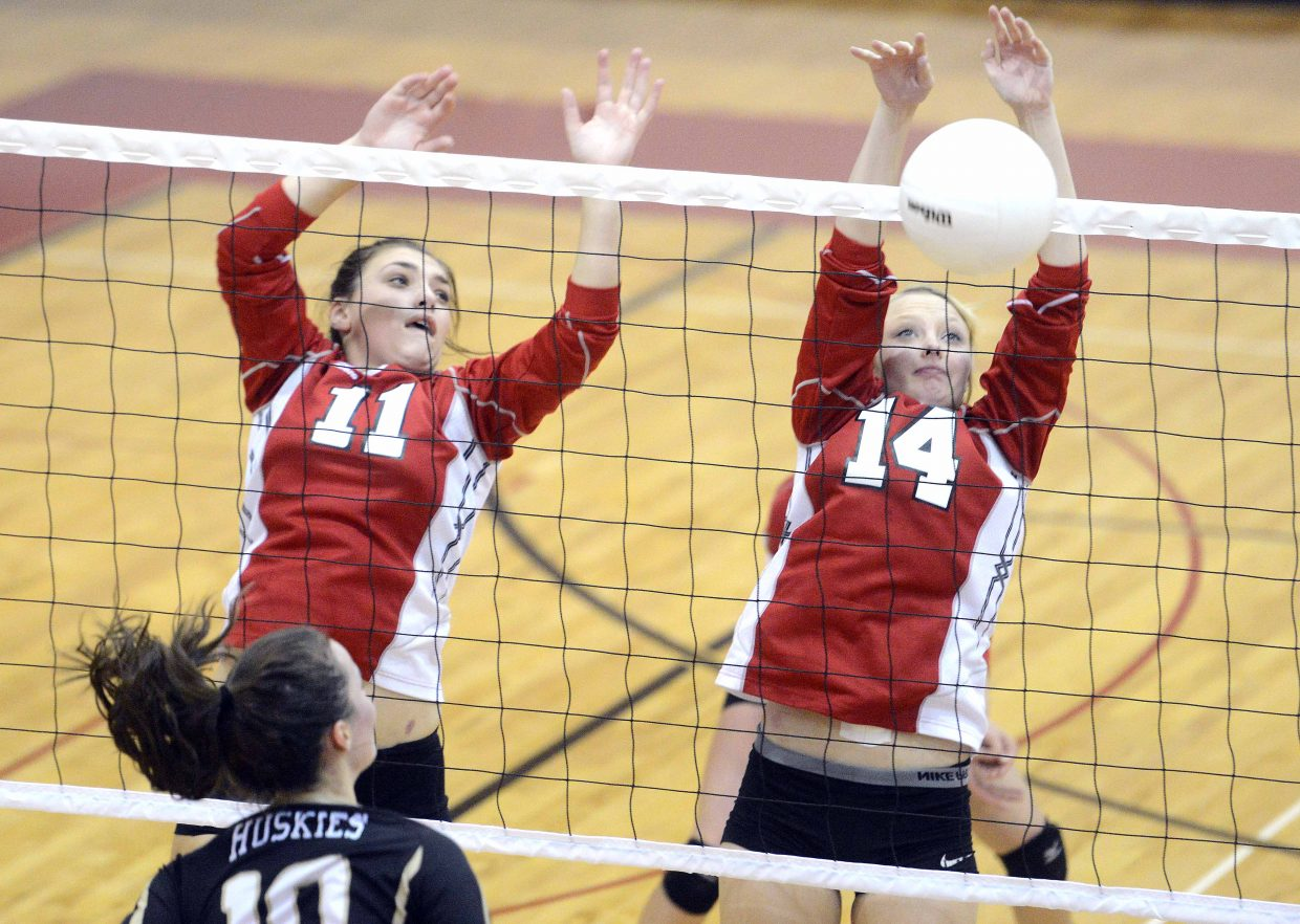 Steamboat's Maddie Robertson, left, and Mikaila Jegtvig block a ball Tuesday against Battle Mountain.
