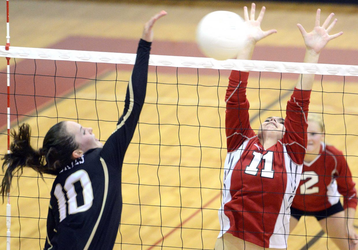 Steamboat's Maddie Robertson tries to get a block on Battle Mountain's LaRose Currie on Tuesday. The Huskies won the game in three sets.