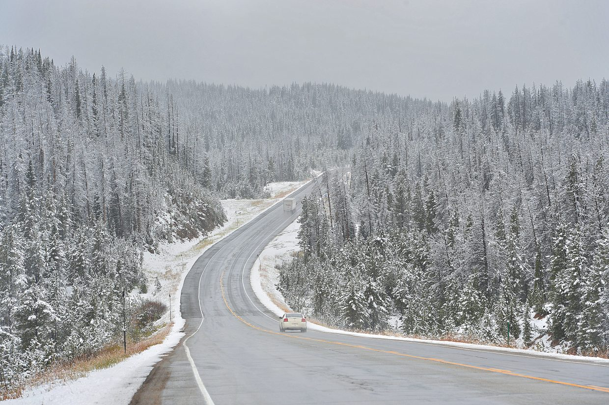 Traffic moves along U.S. Highway 40 on Rabbit Ears Pass on Wednesday morning. The higher elevations received several inches of snow, but for the most part the roadway was clear.