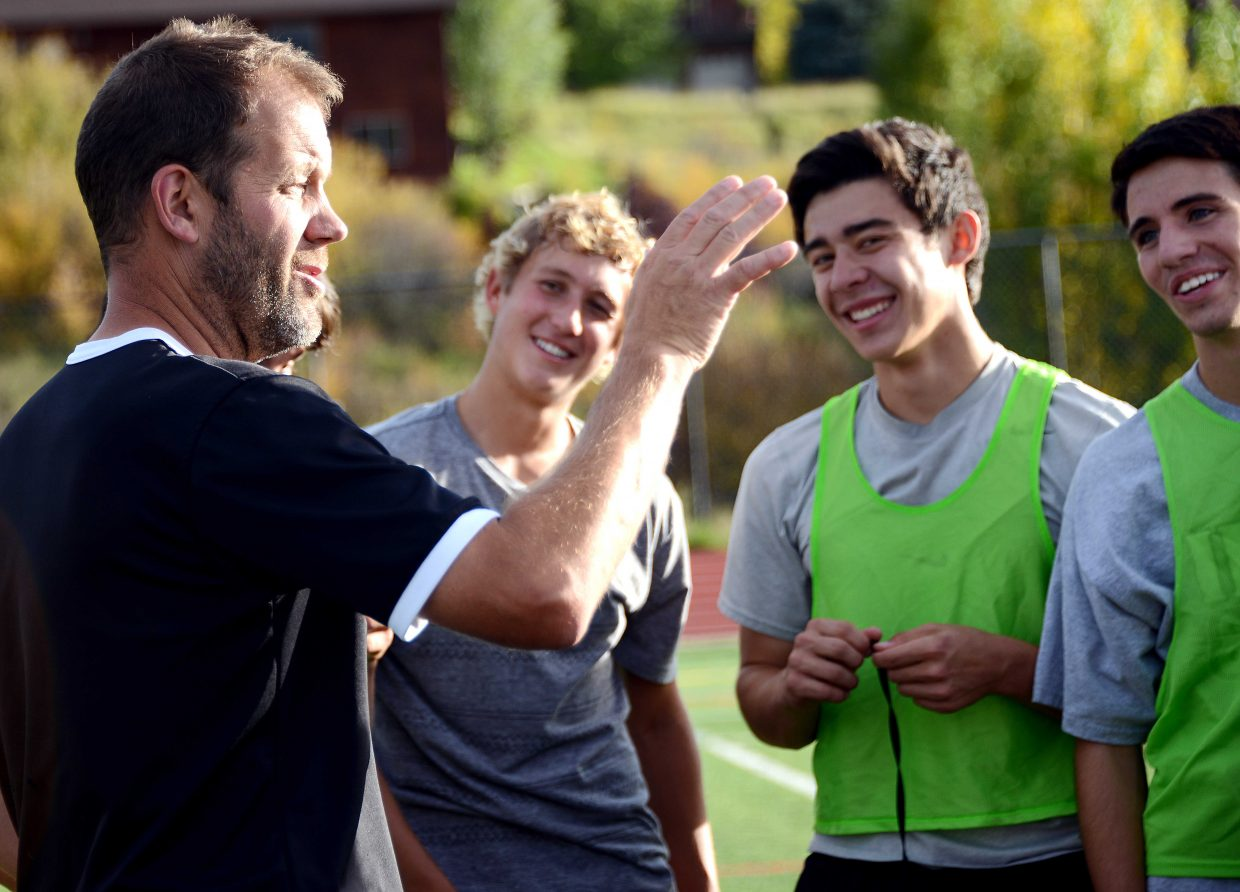 Rob Bohlmann consults his team after Wednesday night's practice. The Steamboat Springs High School soccer team plays at 6 p.m. Thursday against defending state champ Battle Mountain.