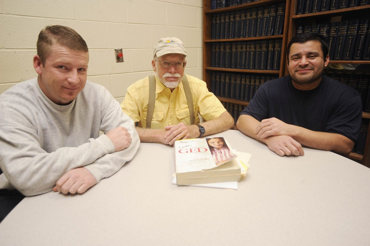 For the past four years, retired teacher Fran Conlon, middle, has been volunteering his time to tutor Routt County Jail inmates. Sam Wisecup Jr., left, and Oswaldo Solano Ortíz were the jail's first inmates to receive their GED diplomas.