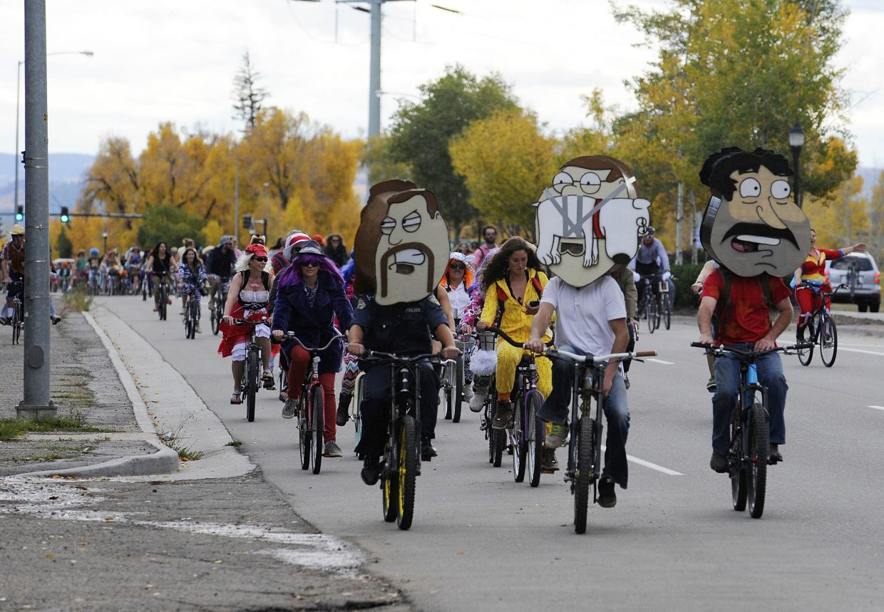 Steamboat Springs Mustache Ride participants bike down Lincoln Avenue on Saturday. The annual bar crawl raises money for the Routt County Humane Society.