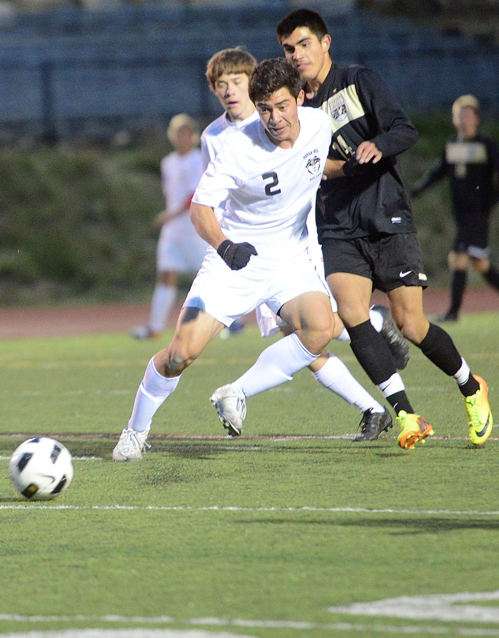 Steamboat's Michael Wong fights for a ball Thursday against Battle Mountain.