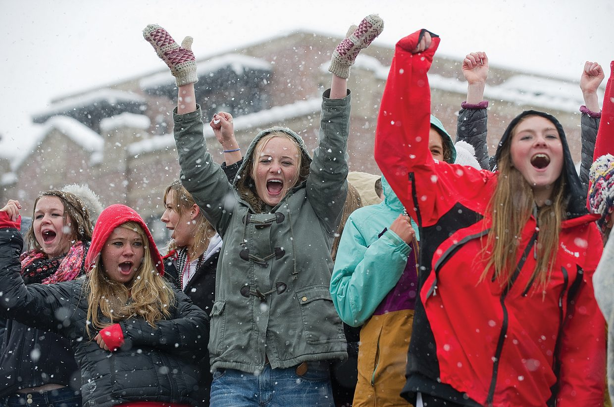 Mariah Hoots shows her spirit during Friday's homecoming parade along Lincoln Avenue in Steamboat Springs. The students at Steamboat Springs High School didn't let a day of heavy snow and chilly temperatures dampen their spirits.