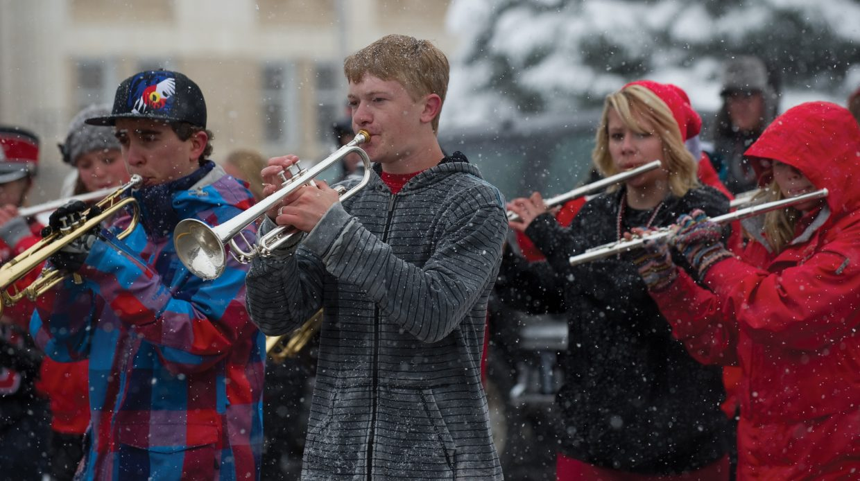 Trumpet player Nick Martin and the Steamboat Springs High School marching band braved the elements Friday afternoon to lead the homecoming parade down Lincoln Avenue.