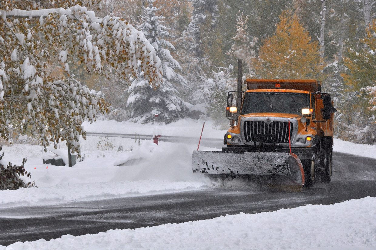 A city snowplow clears heavy snow off of Aspen Wood Lane on Oct. 4. Since that storm, the city's snow removal fleet has deployed about 40 times.