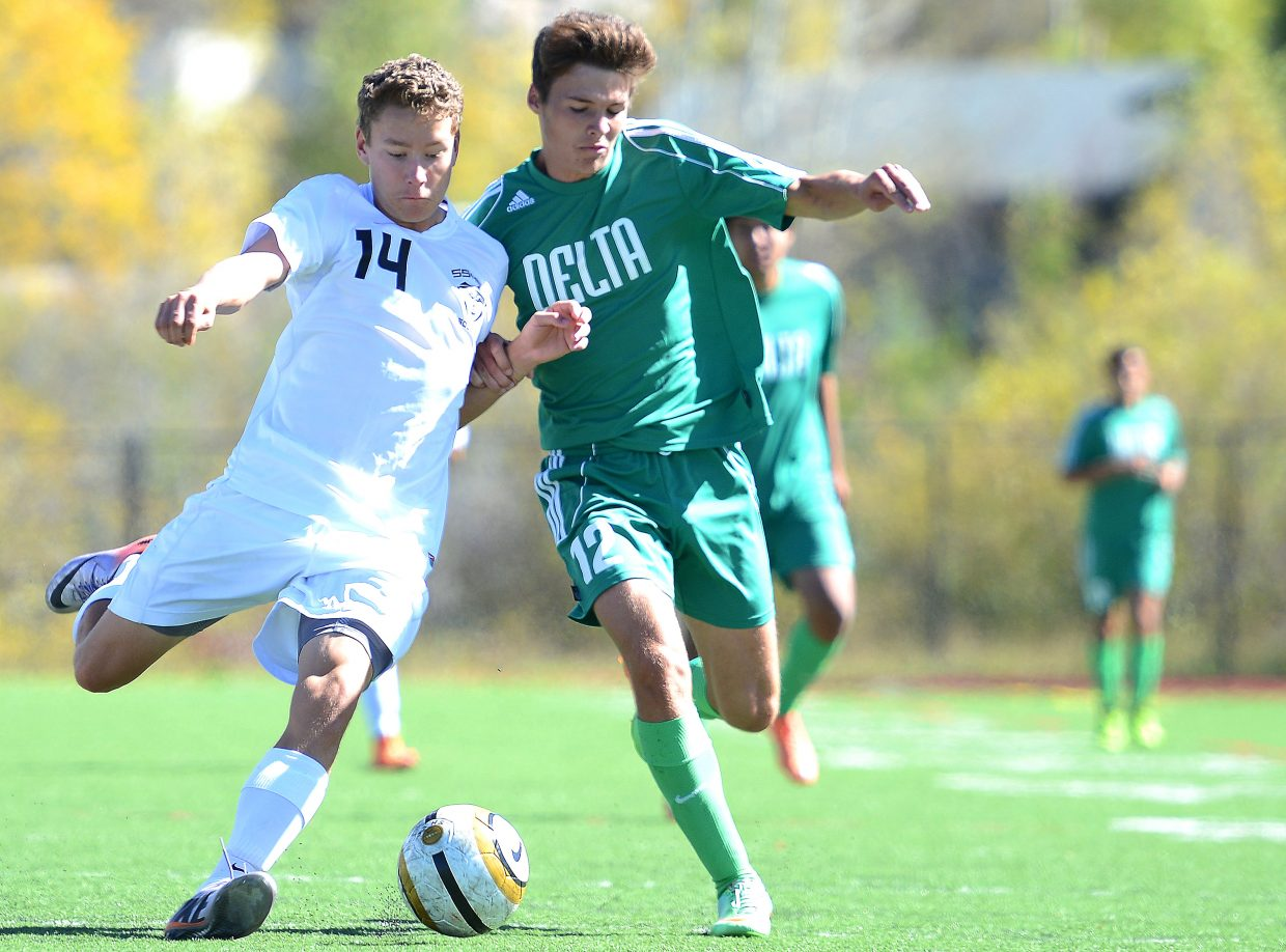 Ross Stuart battles for the ball Saturday with Delta's Jack Bair. Steamboat came away from the game with a 2-0 win.