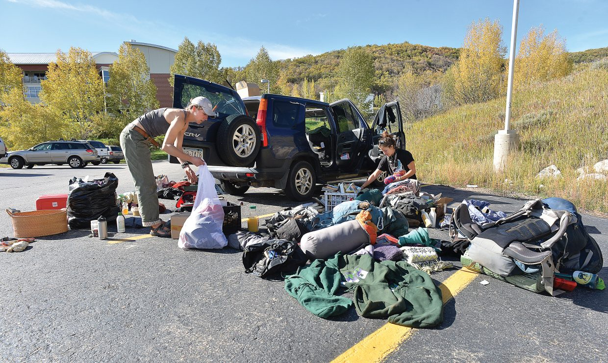 Rebecca Elderkin, left, and her twin sister Christina clean out and pack a 2002 Honda CRV in a parking lot on the Colorado Mountain College campus. The sisters, who just wrapped up work with the Rocky Mountain Youth Corps, needed an open space to unpack, organize and repack the car before heading west to California.