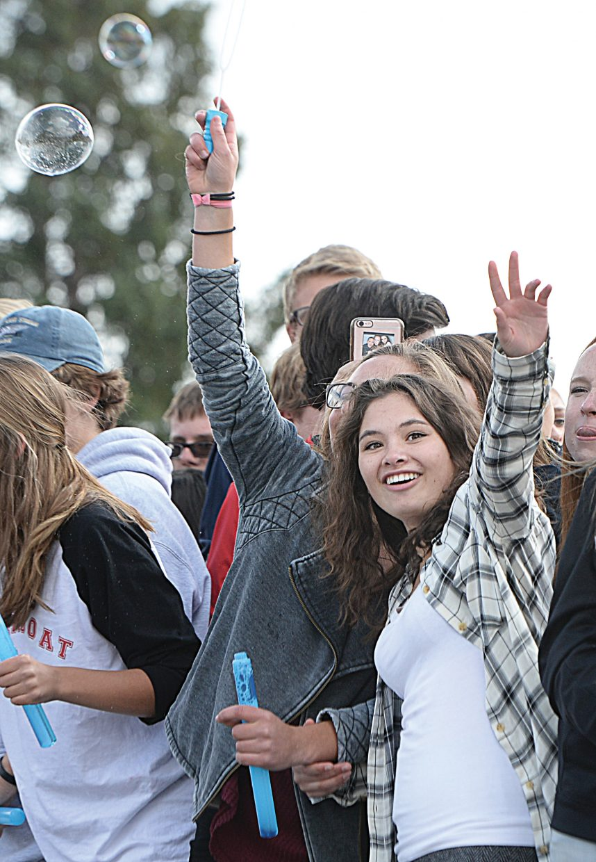 Steamboat Springs High School student Sarah Heineke waves to the crowd while celebrating with her classmates at the 2016 homecoming parade Thursday afternoon on Lincoln Avenue. Homecoming week will continue Friday evening with the homecoming football game and then Saturday with the big dance.