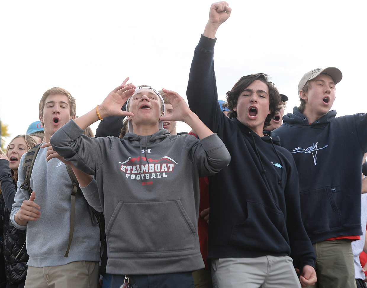 Sophomore Johnathon Kaminiski, middle, shows his spirit along with Tyden Baker, left, Cameron Colombo, to his right, and Matthew Kempers, far right, during the Steamboat Springs High School Homecoming parade Thursday afternoon on Lincoln Avenue. The big homecoming game will take place Friday with kickoff scheduled for 7 p.m.
