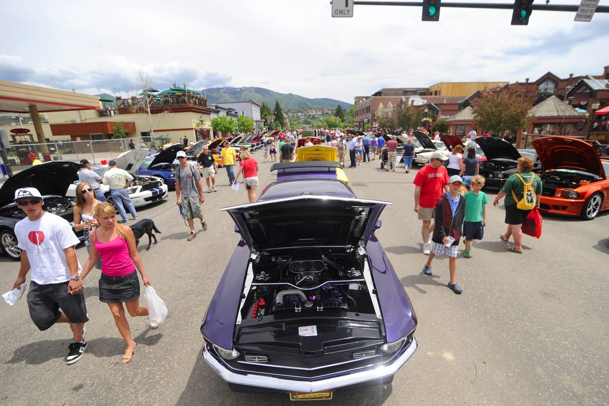 Crowds on Lincoln Avenue check out the Mustangs parked downtown during the annual Mustang Round Up. The Steamboat Springs Chamber Resort Association, the city and the Steamboat Lodging Association have launched a new program that aims to attract more group events like the Mustang Roundup to Steamboat.