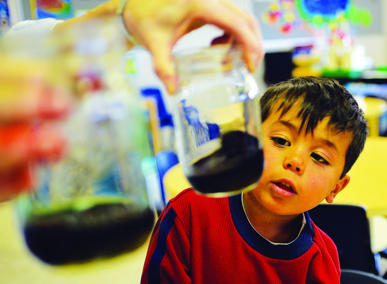 Keller Franko checks out the results of a science experiment at Discovery Learning Center on Friday. The high cost of local child care and the lack of available slots in programs are some of the many topics studied as part of the Routt County Health & Human Services Plan for 2015 to 2017.