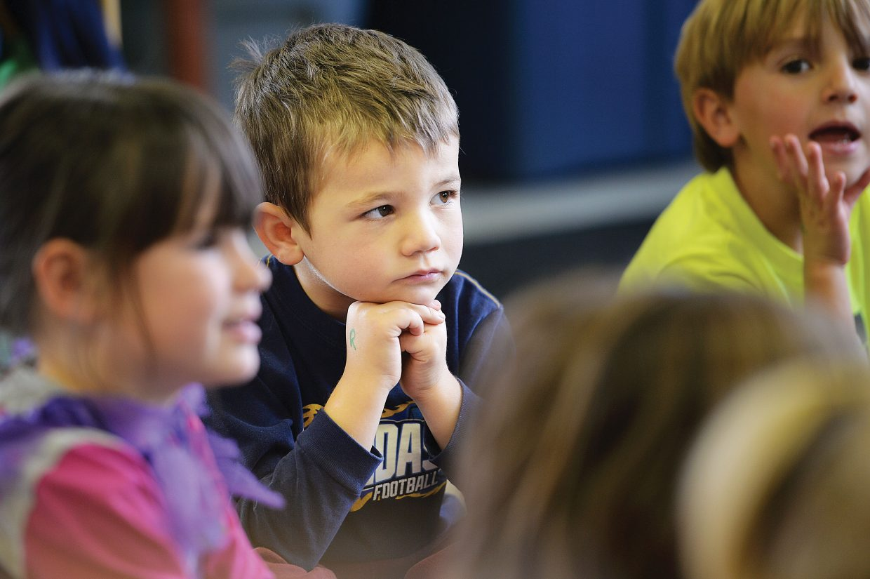 Hayne Merlina listens to his teacher as she reads a book during circle time at the Discovery Learning Center. The high cost of local child care and the lack of available slots in programs are some of the many topics studied as part of the Routt County Health & Human Services Plan for 2015 to 2017.