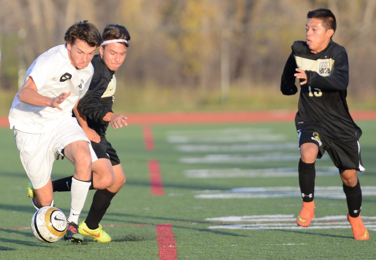 Steamboat's Ross VanHara pushes for the ball Tuesday against Battle Mountain.