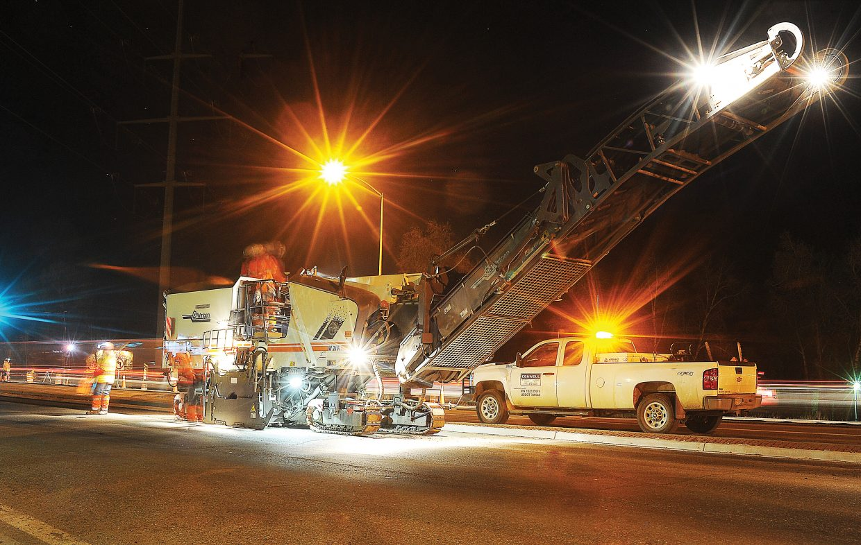 Construction crews strip the pavement at the intersection of U.S. Highway 40 and Anglers Drive on Monday evening. Night work will take place from 7 p.m. to 7 a.m. on the U.S. 40 overlay project through Thursday this week, and from 7 p.m. to 7 a.m. Sunday through Thursday next week. Paving on the stretch will begin Monday and will take place during the day, so drivers should expect delays. The project should be completed by Dec. 5.