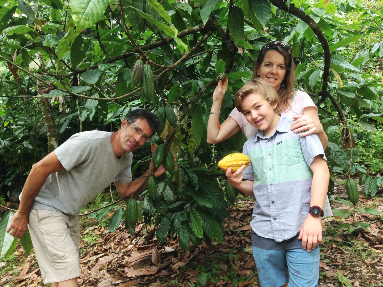 Antonio and Lisa Marxuach, with her son Bennet Gamber inspect a Costa Rican cacao orchard that Antonio helped to renovate.