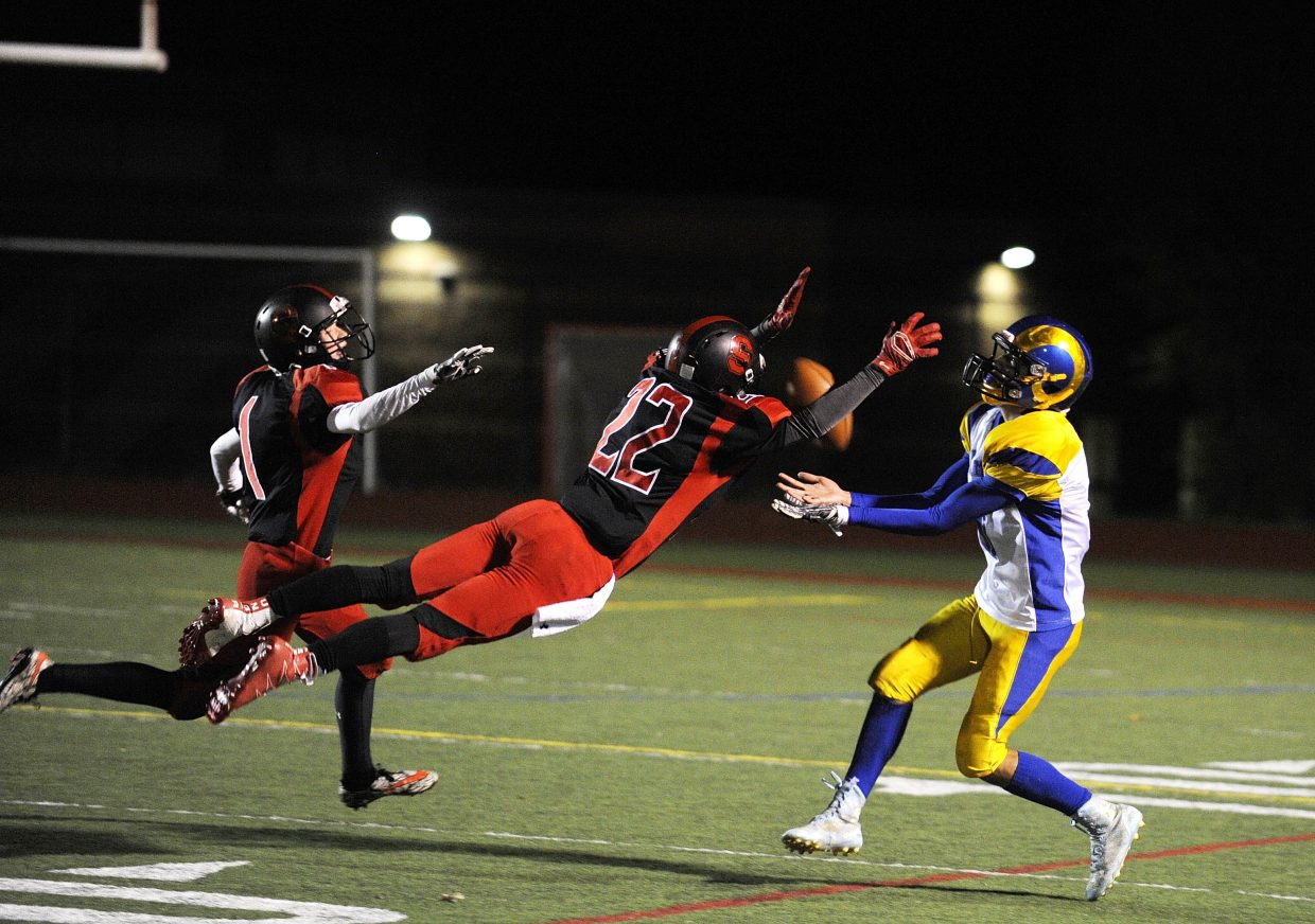 Steamboat Springs High School junior Zach Roach dives in an attempt to keep Roaring Fork's Alex Dominguez from making the catch during Friday homecoming game. Steamboat lost 34-6.