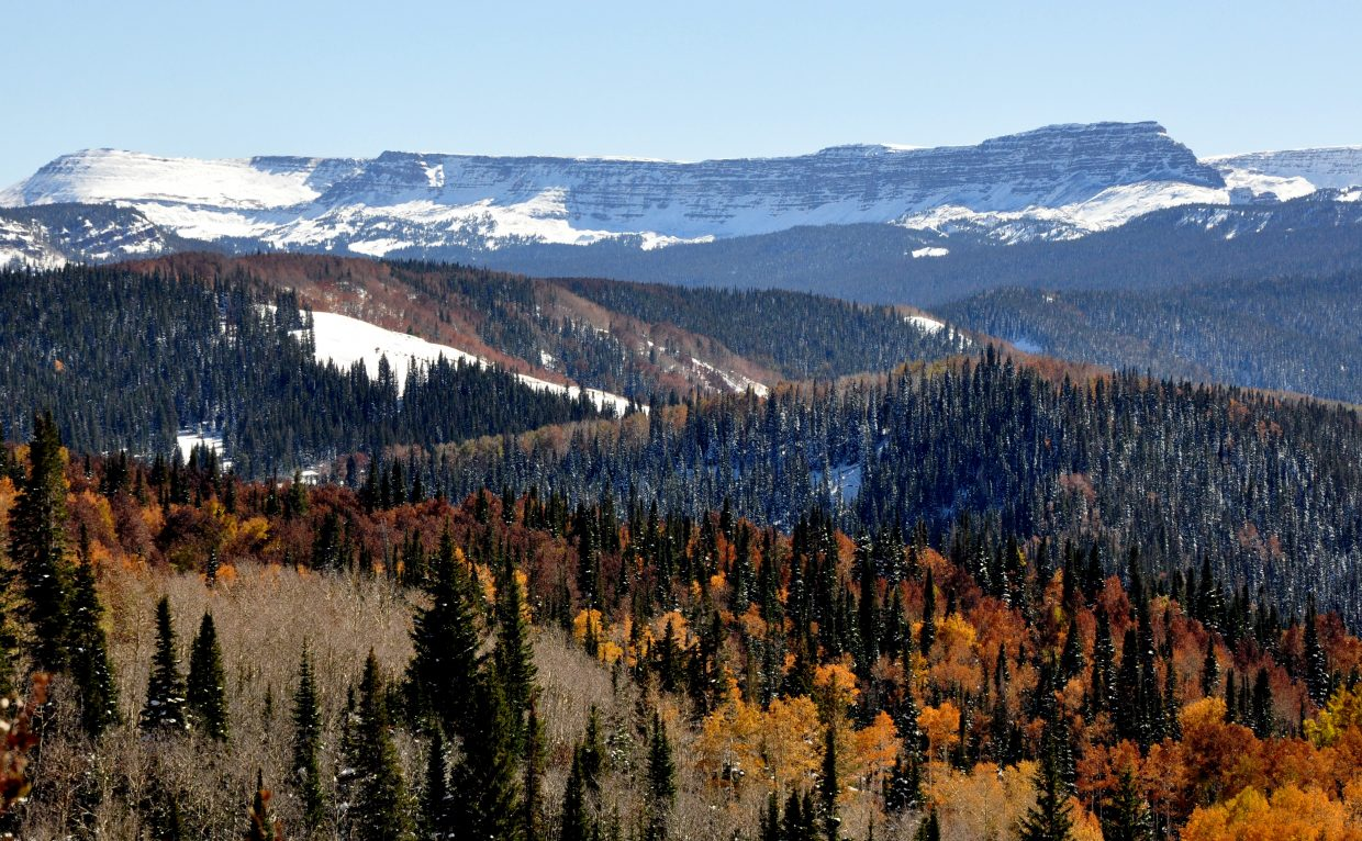 Fall colors are reaching their peak in places like Dunckley Pass south of Steamboat Springs. After several warmer, clear days, some cold and snow is back in the forecast this week.