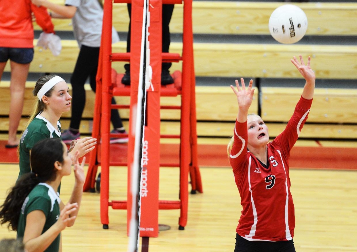 Abigail Wiedel sets the ball for the Steamboat volleyball team Thursday against Summit.