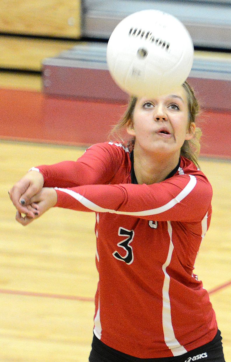 Steamboat's Harper Mattox passes along the ball Thursday against Summit.