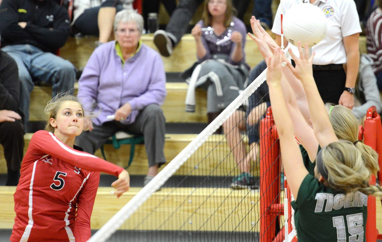 Steamboat's Taylor Harrington watches a hit sail over the net Thursday against Summit. Steamboat won the volleyball match in three sets.