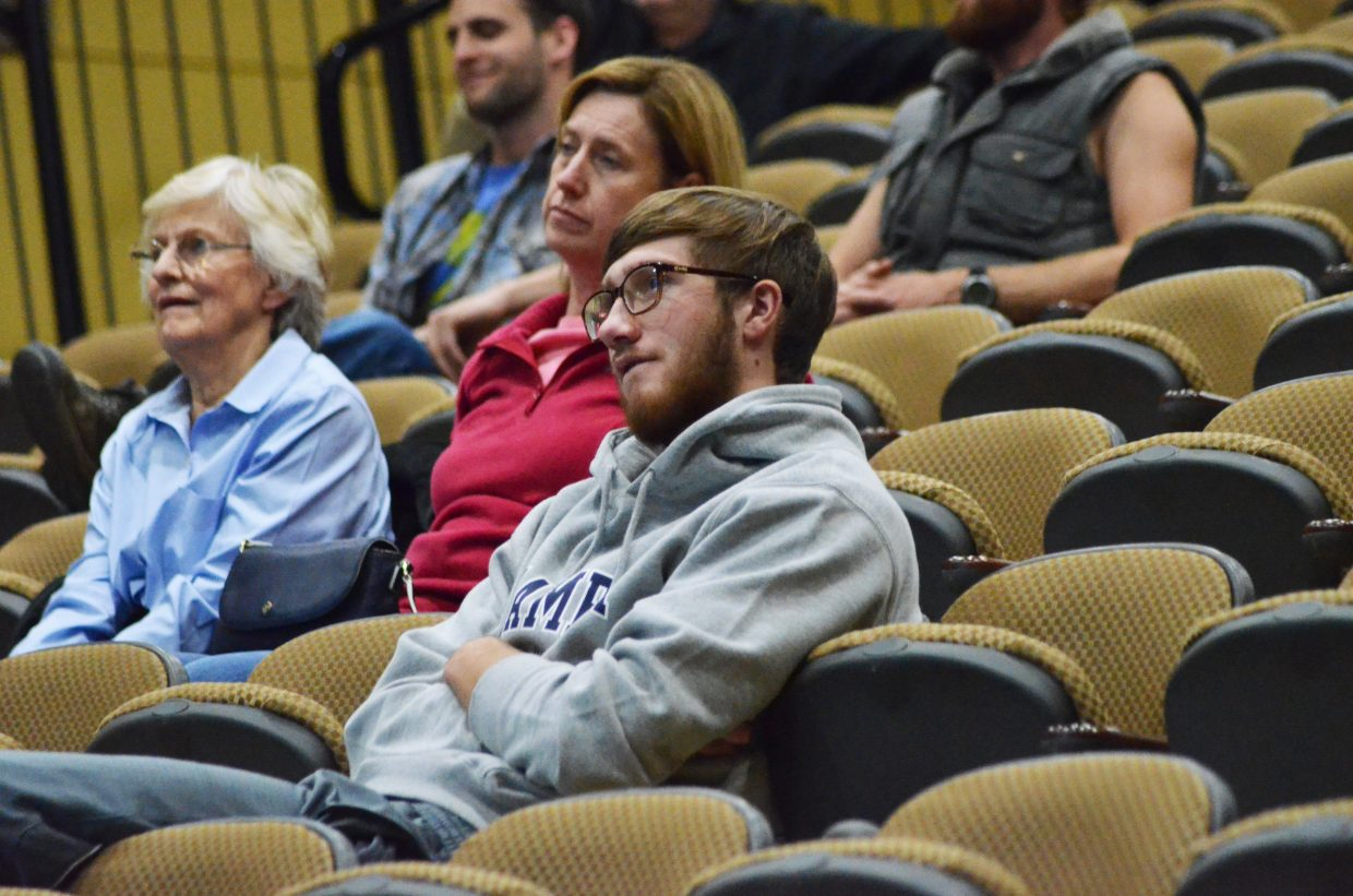 Colorado Mountain College freshman Tanner Magee watches the presidential debate in the CMC auditorium Sunday.