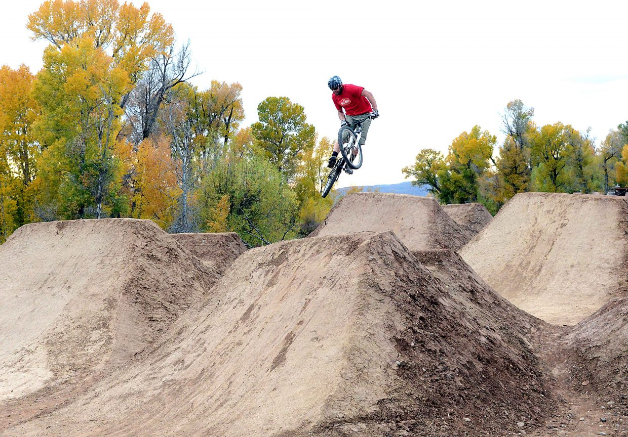 Josh Enck flies high off a jump at the Bear River Bike Park in Steamboat Springs.
