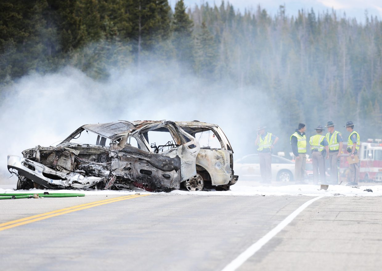 The wreckage of Debra Emal's Ford Expedition sits smoldering in the middle of U.S. Highway 40 on Rabbit Ears Pass.
