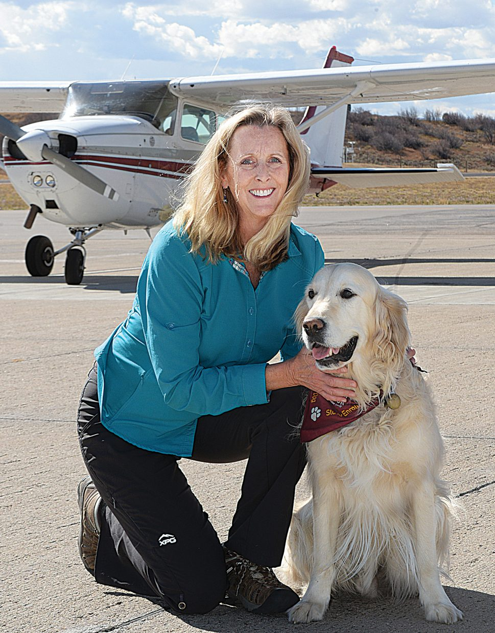 Stacie Fain — pictured with her co-pilot, Rex, the new airport dog — has assumed the role as the Steamboat Springs Airport manager. Fain relocated to Steamboat from Colorado Springs to accept the position at Bob Adams Field.