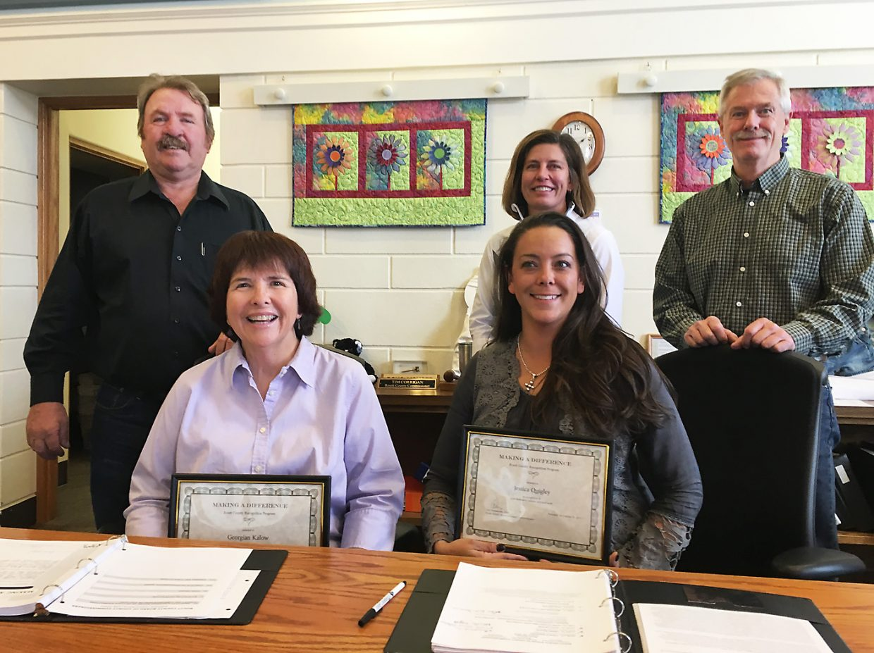 Routt County Human Resources Assistant Georgian Kalow, left foreground, and CSU Extension Assistant Jessica Quigley were recognized Oct. 10 for their devotion to Routt County's core values by the Board of Commissioners Doug Monger, Cari Hermacinski and Tim Corrigan. A third honoree, County Purchasing Agent Marti Hamilton, was unable to attend.