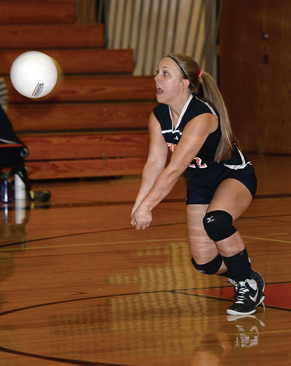 Hayden's Callie Rajzer digs a ball during Monday night's match against the Soroco Rams in Hayden. The Tigers won the first two games but ended up falling to the Rams 3-2 in the match.