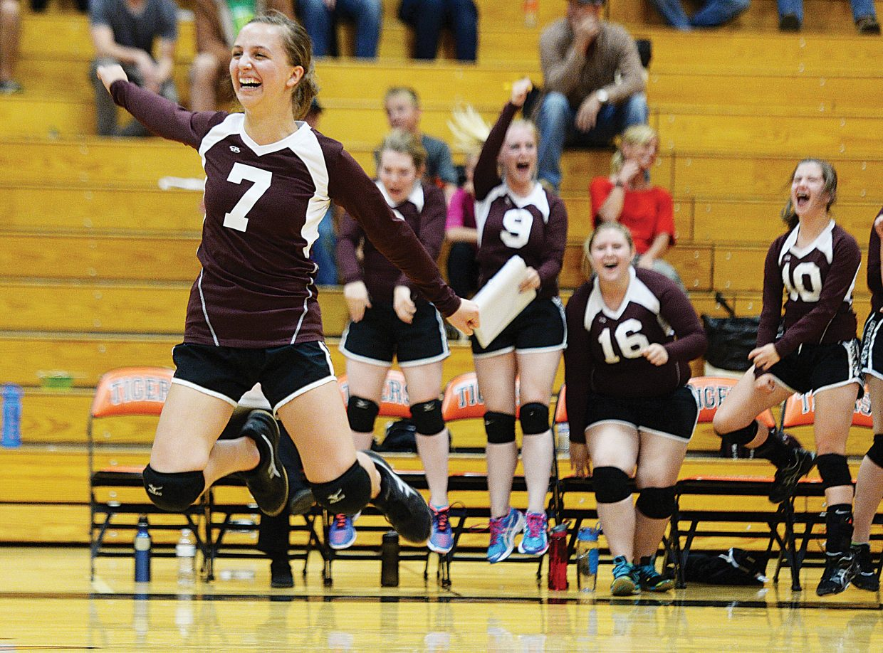 Soroco's Charlee Veilleux jumps in the air as she celebrates the Rams' 17-15 victory in the final game of Monday's volleyball match in Hayden against the Tigers. Hayden took an early 2-0 lead in the match but couldn't stop the Rams' rally, which ended with a 3-2 win.