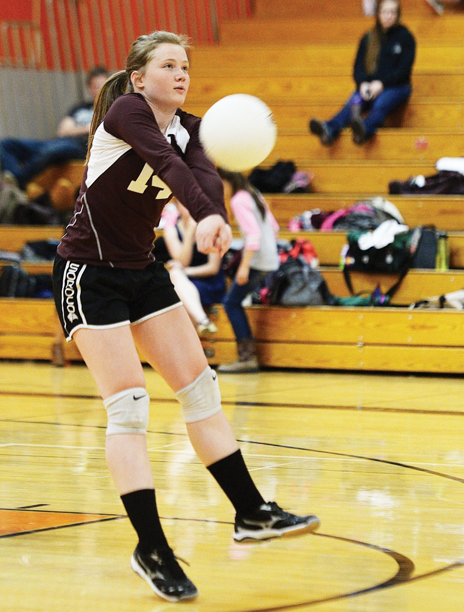 Soroco's Lauren Childers digs a ball during Monday night's match against the Tigers in Hayden. The Rams struggled in the first two games but came back to win the next three, taking the match, 3-2.