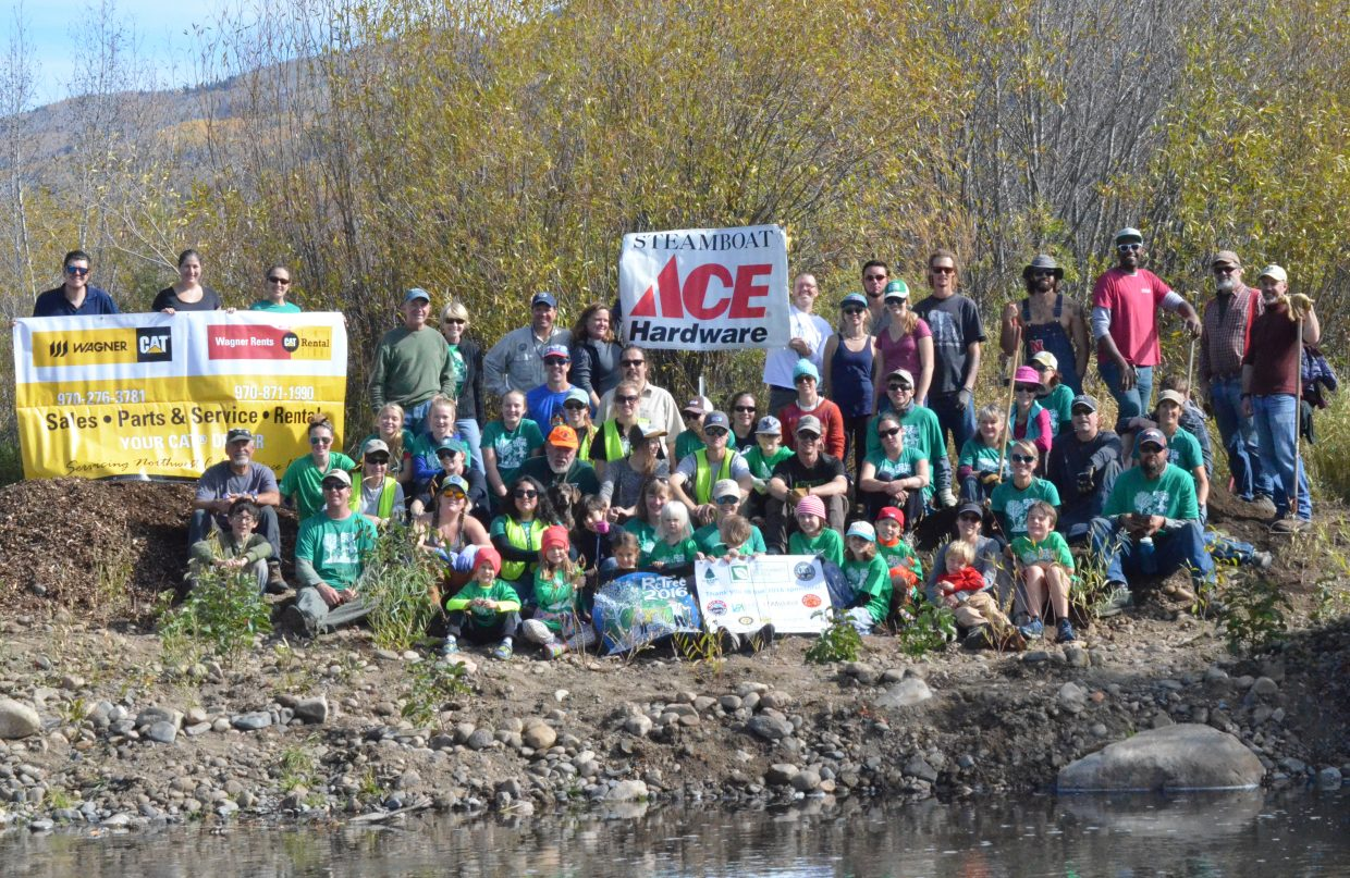 Volunteers with the seventh annual ReTree event, held Saturday at the Chuck Lewis State Wildlife Area, take a moment to survey their work. The volunteers dedicated their Saturday morning to planting about 400 trees along the reconditioned banks of the Yampa River.