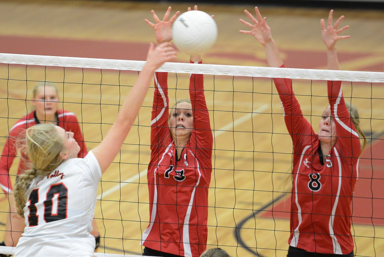 Steamboat's Erica Yaw and Riley Wilkinson get up for a block Saturday against Eagle Valley.