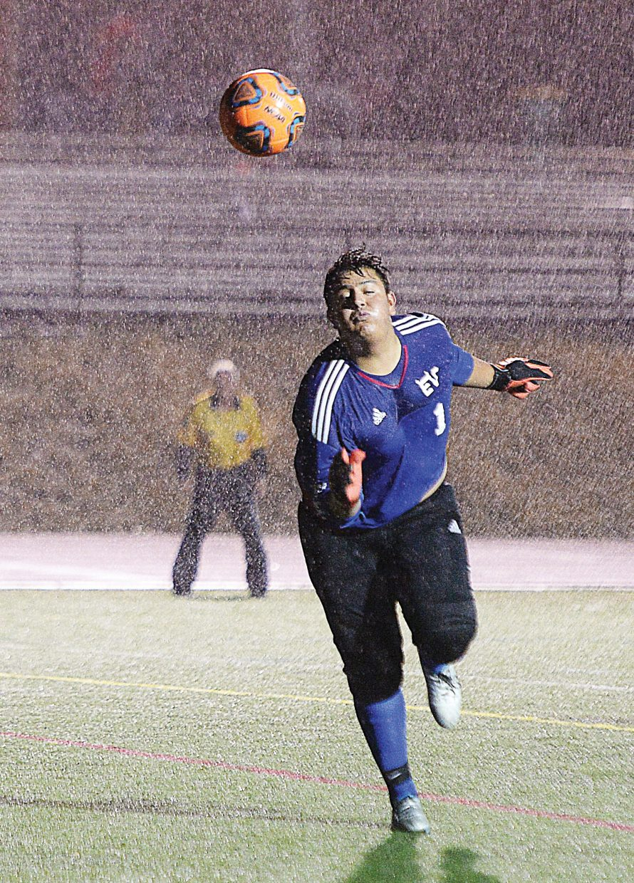 Eagle Valley goalkeeper Ever Ortiz deflects a hard shot out of bounds in the second half of Tuesday night's soccer game in Steamboat Springs. The game was played in periods of heavy rain, but in the end the lights were shining on the Sailors as the team managed to escape with a 3-2 win in the second overtime period.