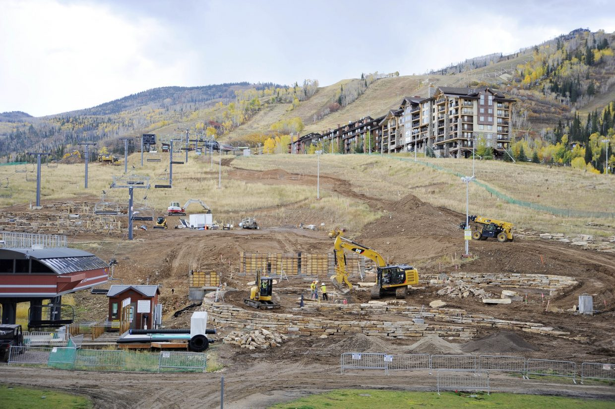 Work progresses Tuesday on construction of a new miniature golf course and mountain coaster being built at Steamboat Ski Area. Large rocks have been laid to match the existing landscaping at the base area. The ski area plans to open the new attractions next year.