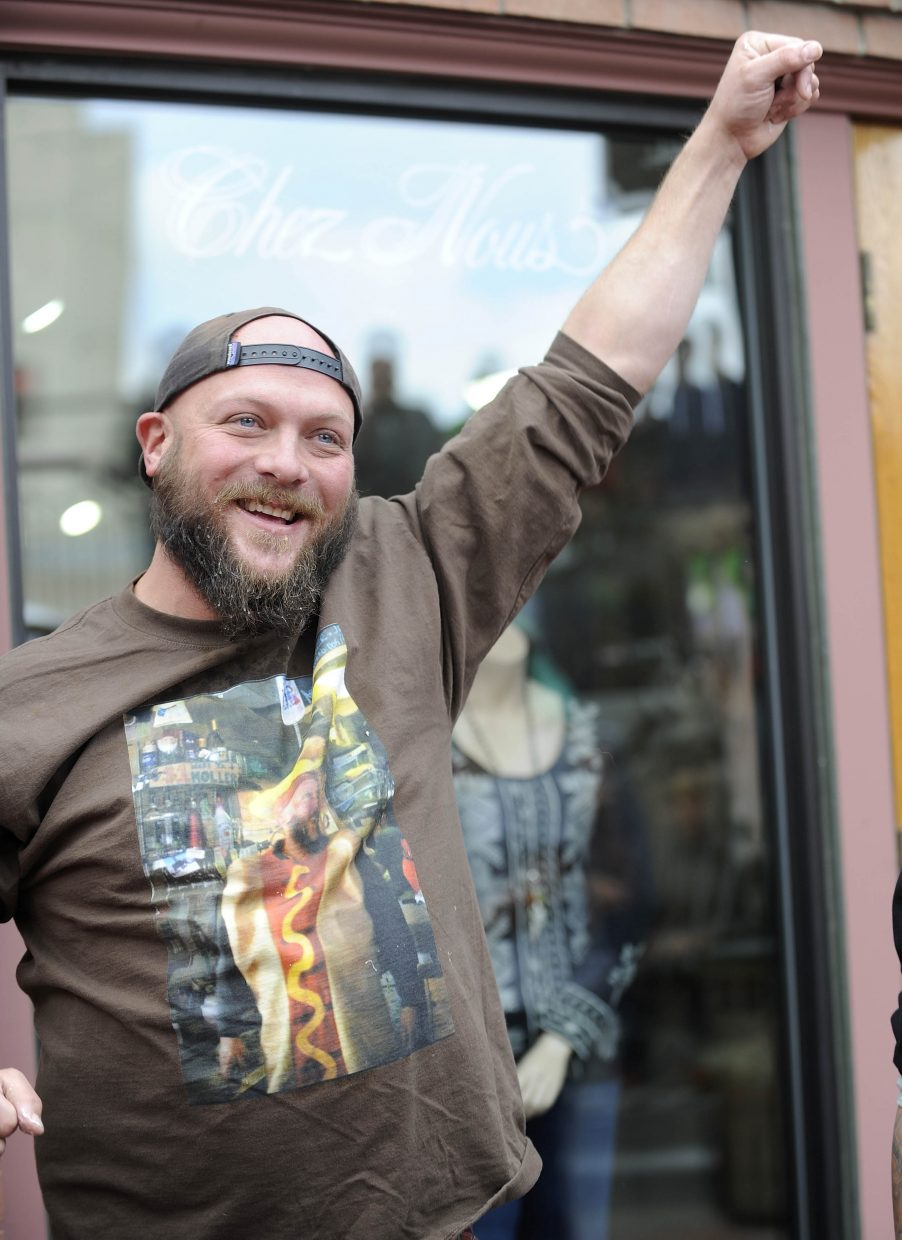 """Steamboat Springs bartender Dick """"Gooch"""" Shine celebrates after winning The Hungry Dog's fourth annual hot dog eating contest at Seventh Street and Lincoln Avenue. Shine won after eating nine hot dogs in five minutes. He tied the record he set in 2012."""
