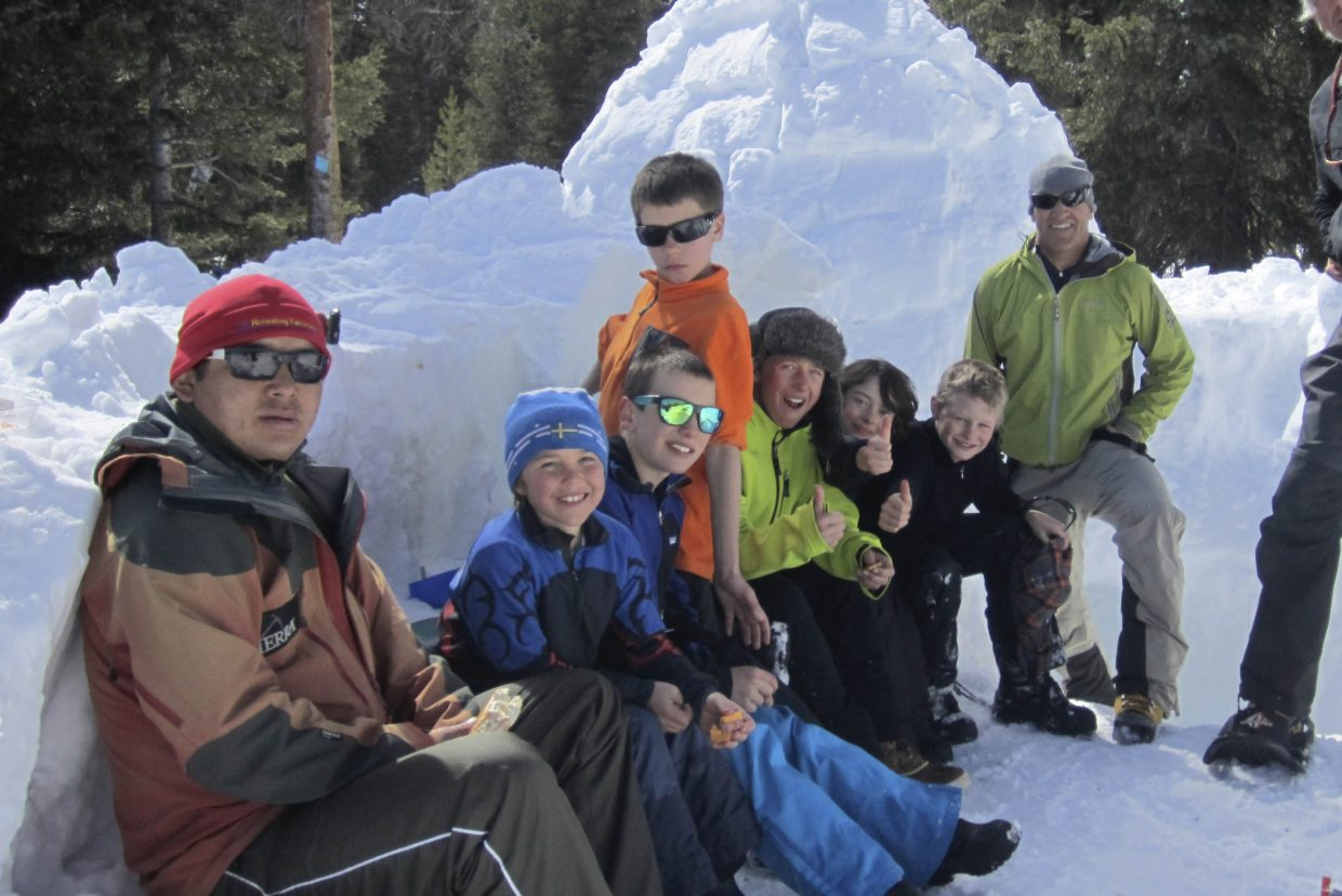 Chhiring Dorje Sherpa, left, frequently has lent a hand to the Everything Outdoor Steamboat program and has helped the middle school students build igloos during winter camping expeditions.