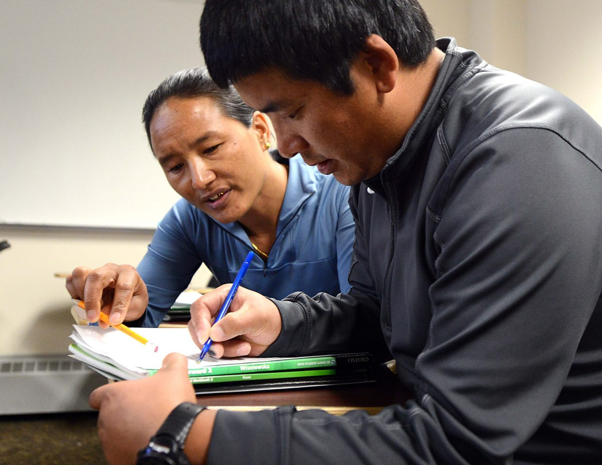 Chhiring Dorje Sherpa and Dawa Phuti Sherpa have said at times it's difficult living so far from their native land, but they're doing what they can to assimilate, including taking twice-weekly English lessons at Colorado Mountain College.