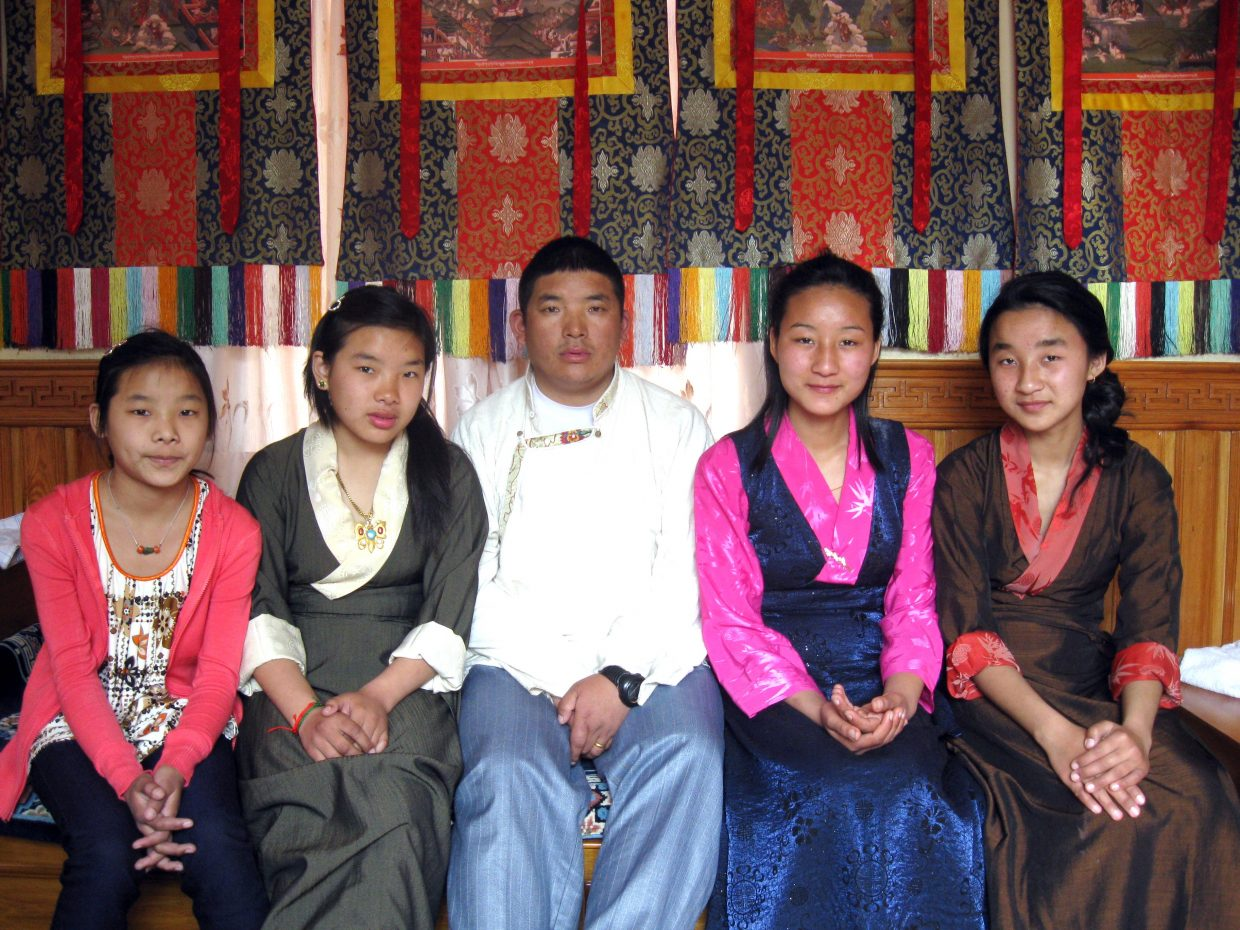 Tensing Phuti Sherpa, Tshering Namdu Sherpa, Chhiring Dorje Sherpa, Dawa Phuti Sherpa and a cousin pose for a picture, top right, in Nepal. Chhiring's climbing helped enable him and Dawa to move to the United States, and they hope to bring their daughters to Steamboat Springs soon. The move may not have been possible if not for the help of some friends in Colorado.