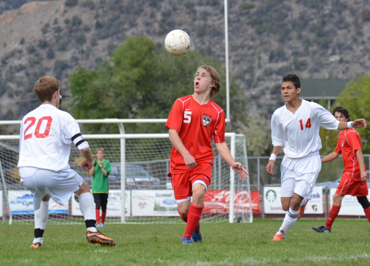 Steamboat's Will Petersen heads a ball in Saturday's game against Glenwood Springs.
