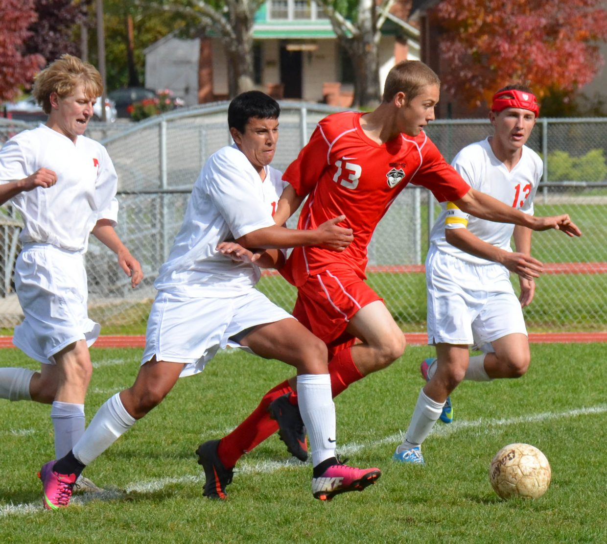 Carter Kounovsky pushes off defenders from Glenwood Springs in Saturday's 2-1 victory for the Sailors.
