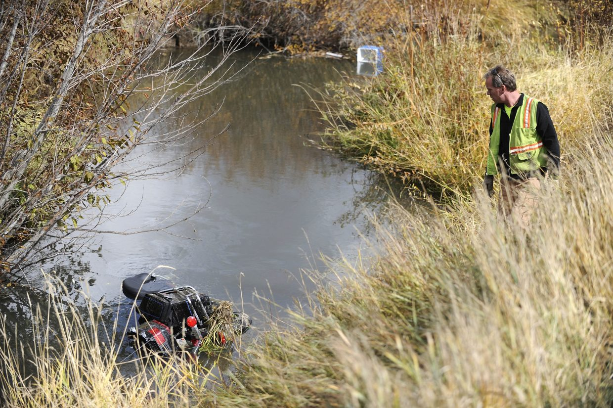 The man driving the motorcycle was pinned under the bike in a ditch next to the road. Motorists driving by freed the man.