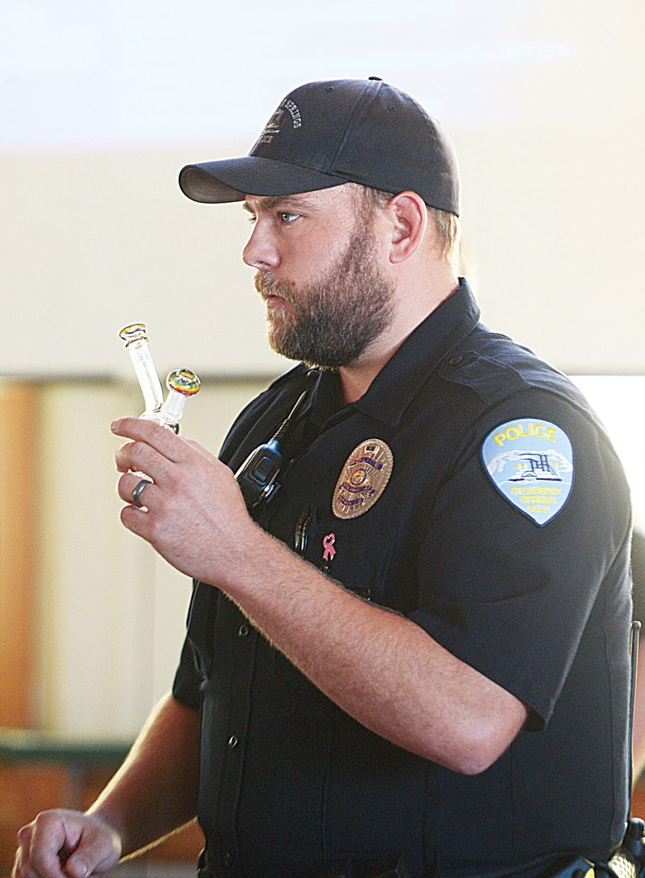 Steamboat Springs school resource officer, Blake Ingerick shows parents and community members different devices used to smoke marijuana at a drug education show & Tell Wednesday afternoon. The program was designed to inform parents about different types of drugs, and the impacts they could have on their children. Ingerick was joined by fellow Steamboat Springs police officer Jon McCartin, who is a drug recognition expert, in the discussion about different drugs, and what parents should look for if they suspect that their children might be experimenting or using.