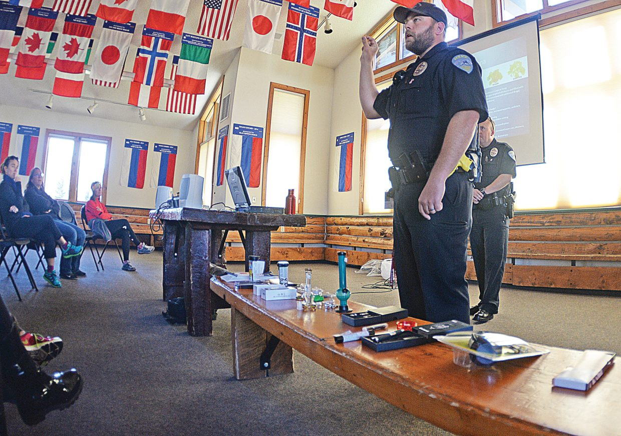 Steamboat Springs School Resource Officer Blake Ingerick shows parents and community members different devices used to smoke marijuana at a drug education Show & Tell Wednesday afternoon. The program was designed to inform parents about different types of drugs, and the impacts they could have on their children. Ingerick was joined by fellow Steamboat Springs Police Officer Jon McCartin, who is a drug recognition expert, in the discussion about different drugs and what parents should look for if they suspect their children might be experimenting or using.