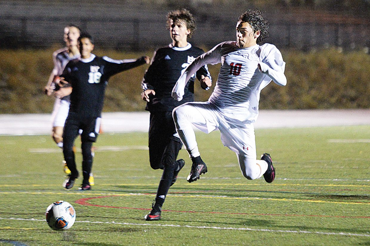 Steamboat's Cruz Archuleta takes a hard shot toward Eagle Valley goalkeeper Ever Ortiz during a breakaway opportunity in the second half of Tuesday's soccer game at Gardner Filed. Steamboat scored late in the game to tie Eagle Valley 2-2, and then Will Beursken's scored the game winning goal in the second overtime period.