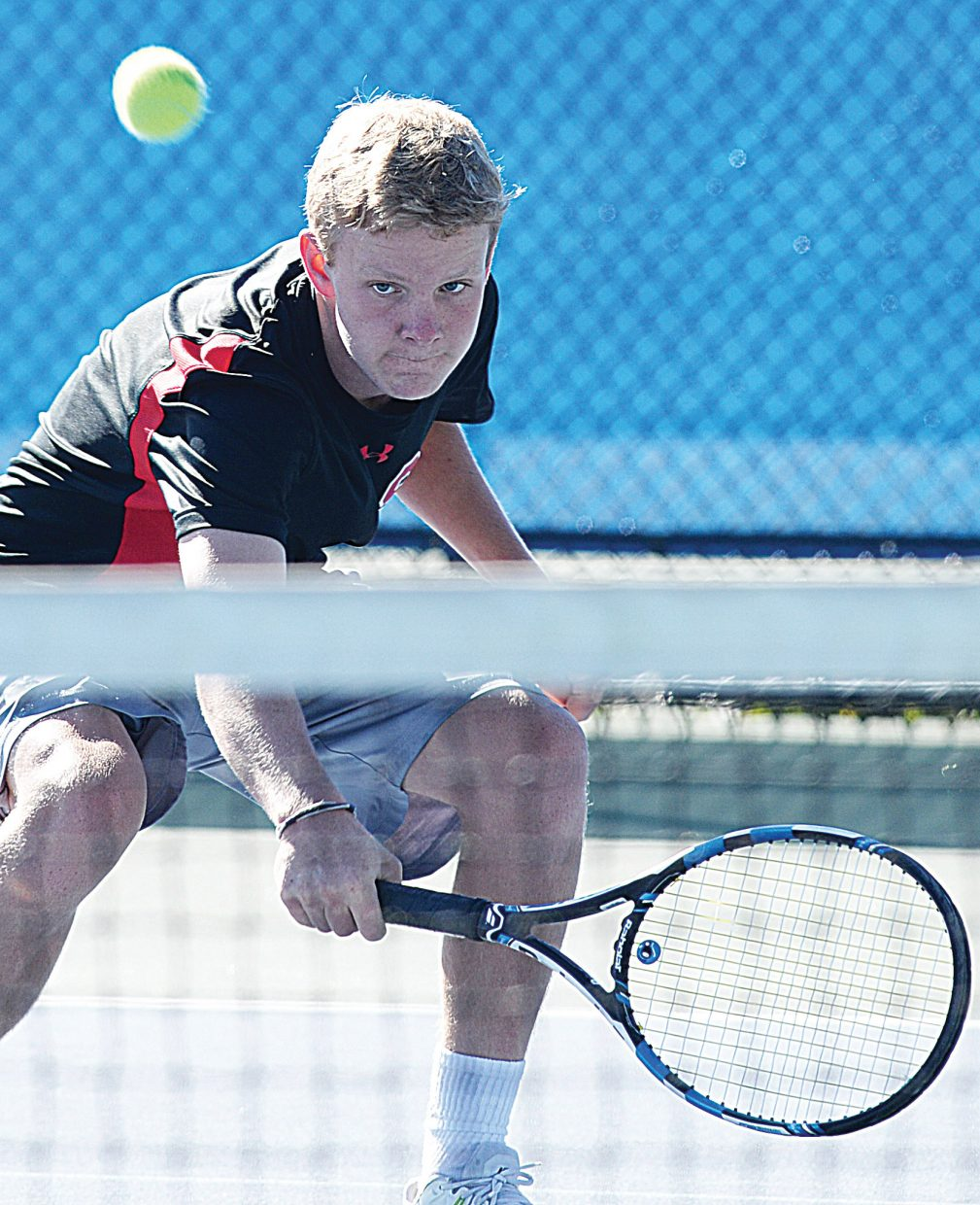 Steamboat Springs Jack Bender returns a shot during a match against Grand Junction earlier this season. Bender will be one of seven seniors who will compete at the state this weekend.